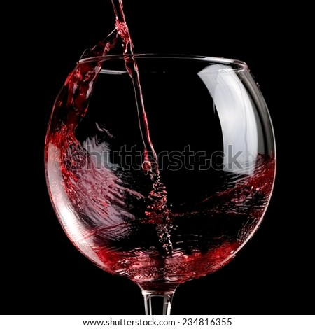Red wine pour, close up - stock photo
