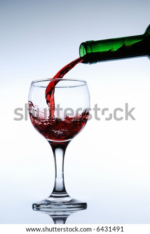 Red wine pour in a glass - stock photo