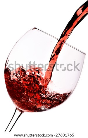 Red wine pour into glass close-up isolated over white background - stock photo