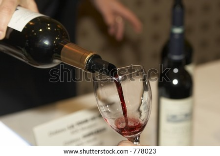 Red wine poured during a bordeaux wine tasting - stock photo