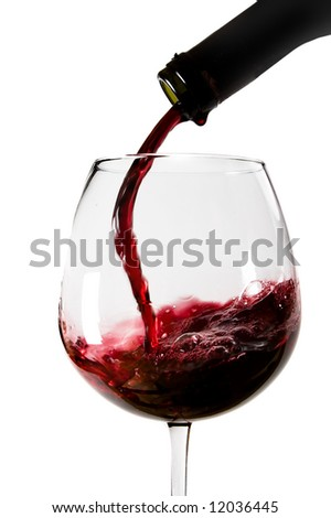 Red wine poured into the glass from the bottle isolated on white background - stock photo
