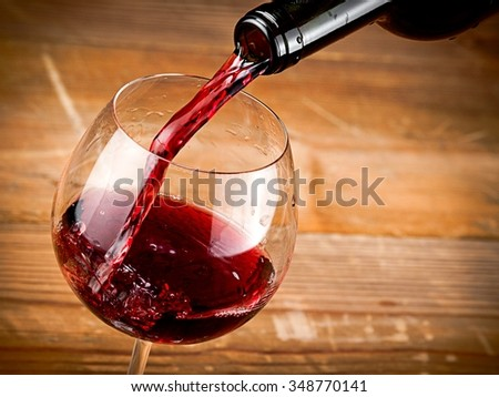 Red wine pouring, close up