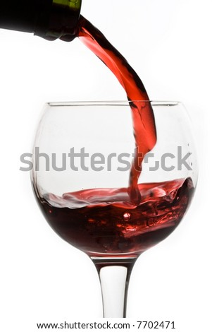 Red wine pouring down from a bottle isolated on white - stock photo