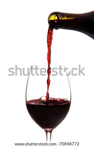 Red wine pouring down from a wine bottle isolated on white - stock photo