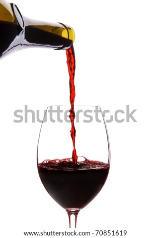 Red wine pouring down from a wine bottle isolated on white