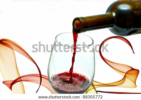 Red wine pouring down from a wine bottle, isolated on white - stock photo