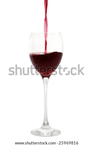 Red wine pouring in a wineglass - stock photo