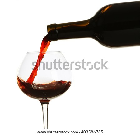 Red wine pouring in glass, isolated on white - stock photo
