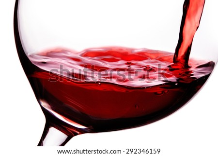 Red wine pouring in to the glass . closeup macro shot isolated on white with clipping path.  - stock photo