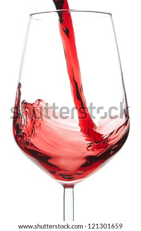 Red wine pouring into a crystal glass. On a white background.