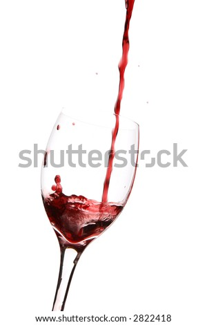 red wine pouring into a glass, vertical on white background