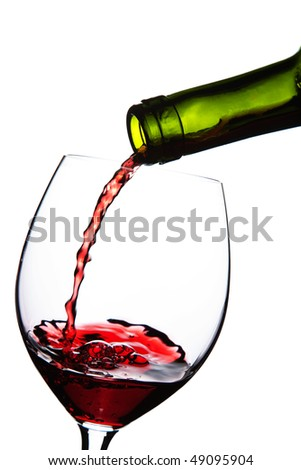 red wine pouring into glass isolated - stock photo
