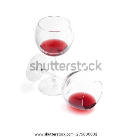 Red wine pouring into wine glass, close-up isolated on white background. Flat mock up for design. - stock photo