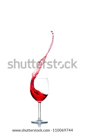 red wine pouring into wine glass isolated on a white background