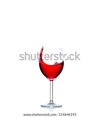 red wine pouring into wine glass isolated on a white background - stock photo