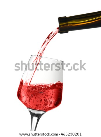 Red wine pouring into wine glass, isolated on white