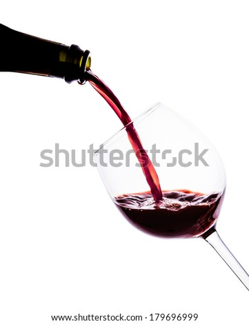 Red wine pouring into wine glass. isolated with clipping path.   - stock photo