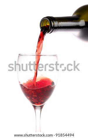 red wine pouring with white background - stock photo