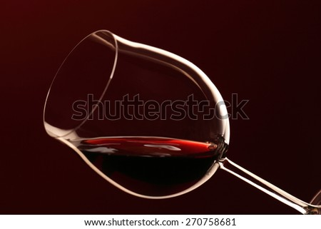 Red wine/ red wine glass isolated on red background