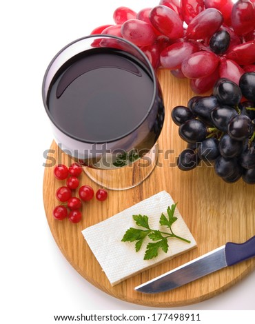 Red wine, sheep cheese and grapes isolated on white background - stock photo