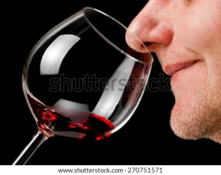 Red wine smelling, close up - stock photo