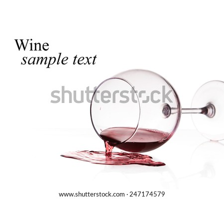 Red wine spilled from glass over white background(with sample text) - stock photo