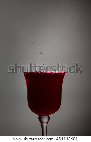 Red wine splash in wineglass