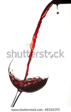 Red wine splash on a glass, white background. - stock photo