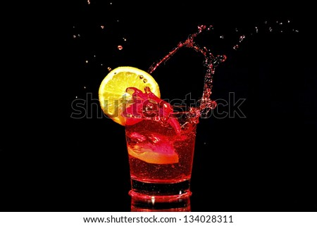 Red wine splash with a slice of orange