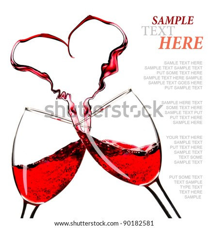 Red wine splashes into shape of heart - stock photo
