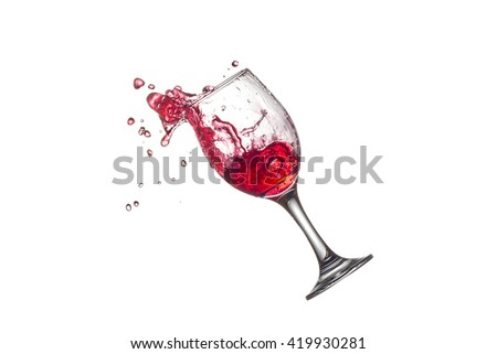 red wine splashing in wine glass on white background. - stock photo