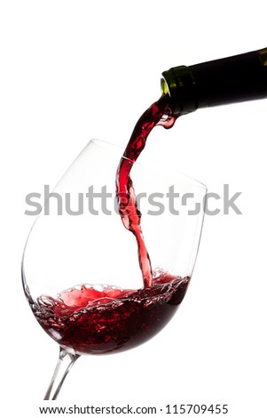 Red wine splashing on  a glass and bottle - stock photo