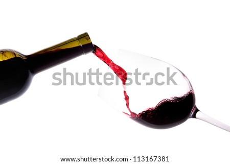 Red wine splashing on a white background - stock photo
