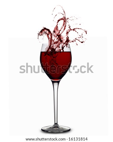 Red wine splashing out of a glass - stock photo