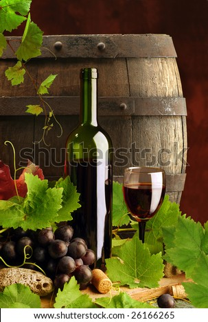 Red wine still life with grapevine and cask - stock photo