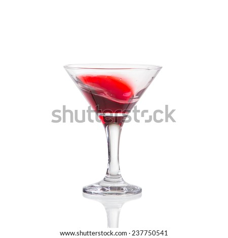 red wine swirling in a goblet martini glass, isolated on a white background