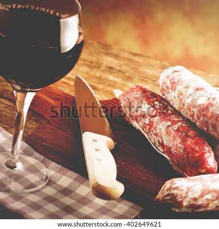 red wine tasting with salami - vintage style photo