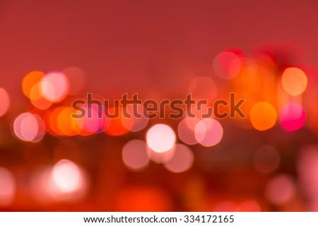 Red wine tone blur bokeh light. Defocused background. - stock photo