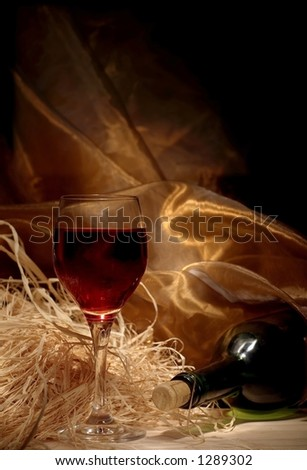 Red wine with bottle still life - stock photo