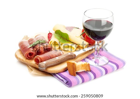 Red wine with cheese, prosciutto, bread, vegetables and spices. Isolated on white background - stock photo