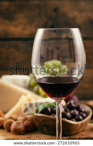 Red wine with Cheese variety.Food background.  Fresh snacks on wood - stock photo
