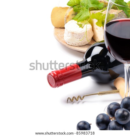 Red wine with French cheese selection over white - stock photo