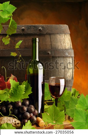 Red wine with fresh grapevine and cask