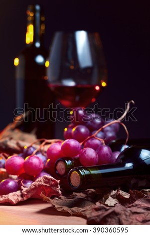 red wine with grapes and vine leaves - stock photo