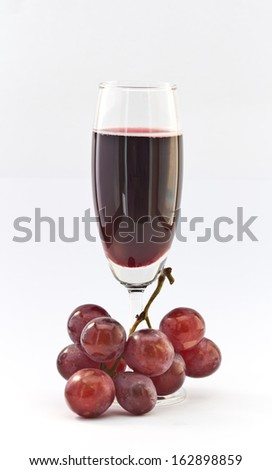 Red wine with grapes on white background