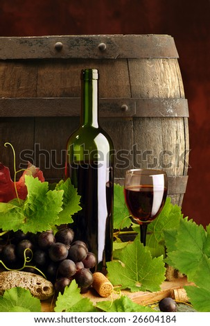 Red wine with grapevine and cask - stock photo