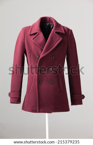 red winter coat isolated on gray background - stock photo