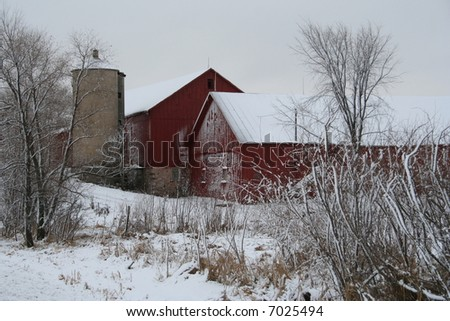 red Wisconsin barn in winter - stock photo