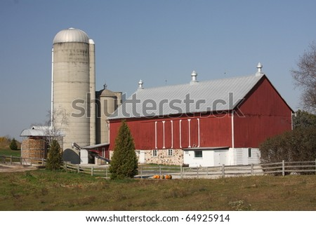 red Wisconsin dairy barn with concrete silo - stock photo