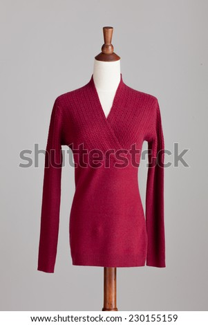 red woman cashmere sweater with wood model on grey isolated - stock photo